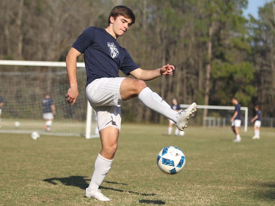 Maclay's Jordan Pichard participates in a drill during practice prior to the Marauders' Class 1A state championship game.