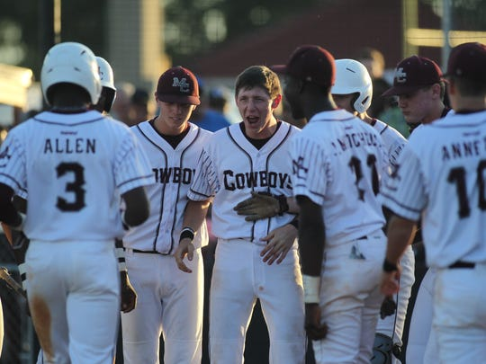 Teammates wait to mob Madison County's Kris Allen after he hit a two-run home run against Mayo Lafayette in a regional final. The Cowboys won 3-2 to reach the state tournament for the first time in program history.