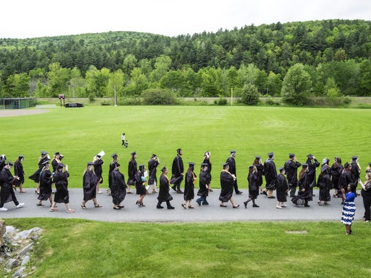 CCV graduates make their way to Shapiro Field House at Norwich University for the the college's 50th commencement ceremony.