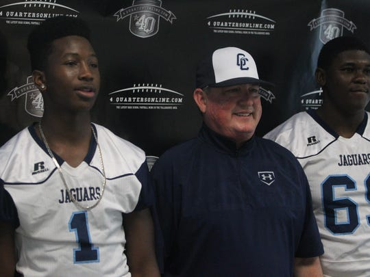 Gadsden County coach Joey Striplin poses for a picture with his players during Tuesday's 7th annual 4QuartersOnline Media Day.