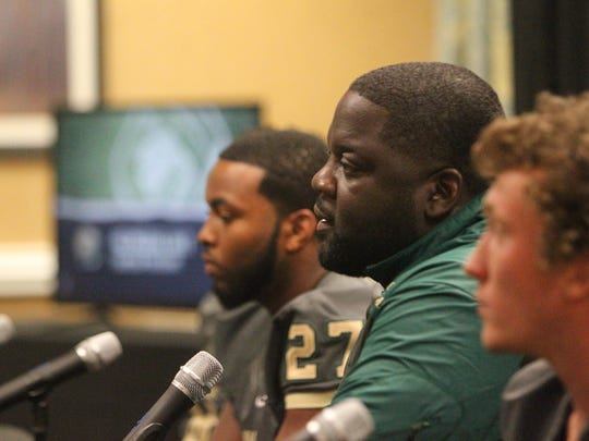 Lincoln coach Quinn Gray speaks during Tuesday's 7th annual 4QuartersOnline Media Day.