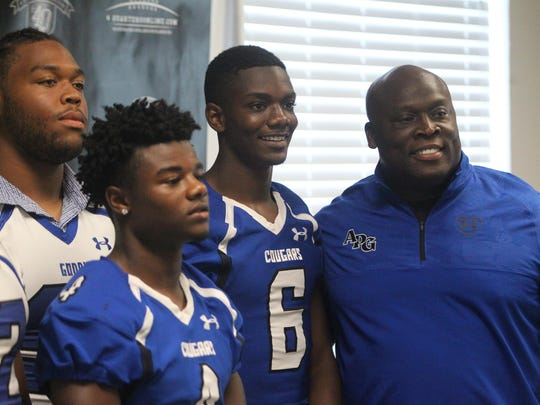 Godby coach Corey Fuller and players pose for a picture during Tuesday's 7th annual 4QuartersOnline Media Day.
