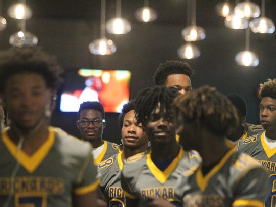 Rickards football players walk into City Church for the 4th annual Team Tallahassee football kick-off dinner.
