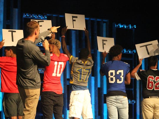 Area high schools compete in football trivia against each other to determine which school would eat first at the 4th annual Team Tallahassee football kick-off dinner on Friday night at City Church.