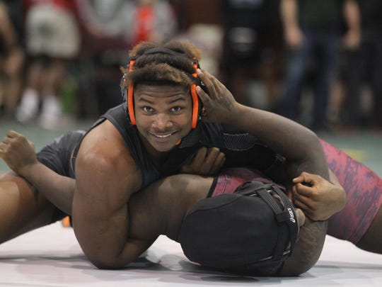 Cam Brown smiles for the camera while calmly pinning his opponent during the Capital City Classic this past season.