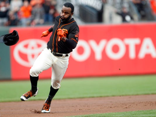 San Francisco Giants' Denard Span rounds third base on an inside-the-park home run during a baseball game against the Philadelphia Phillies, Saturday, Aug. 19, 2017, in San Francisco. (AP Photo/Mathew Sumner)