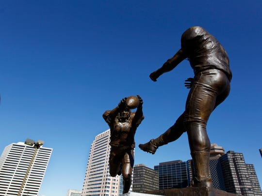 FILE - In this Nov. 8, 2012, file photo, the bronze statue titled 'Rebirth,' which shows former New Orleans Saints' Steve Gleason blocking a punt against the Atlanta Falcons during the first Monday Night Football game after the Superdome reopened, after Hurricane Katrina, is seen outside the Mercedes-Benz Superdome in New Orleans. Memories won't feed a family or rebuild their house, which is why the first thing J.J. Watt brought back to his adopted hometown in the wake of Hurricane Harvey was $28 million in cold, hard cash. So when the Texans open the NFL season Sunday against Jacksonville at NRG Stadium, Watt and his teammates want to deliver a different kind of gift _ one of those iconic sports moments that will live long after the flood waters recede. (AP Photo/Gerald Herbert, File)
