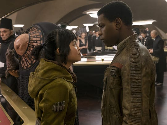 "This image released by Lucasfilm shows Kelly Marie Tran, left, and John Boyega in ""Star Wars: The Last Jedi."" (David James/Lucasfilm via AP)"