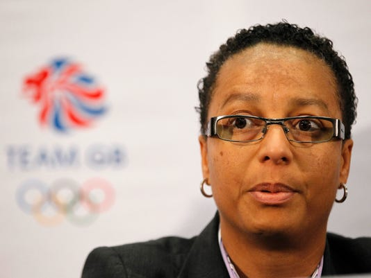 FILE - A Thursday, Oct. 20, 2011 file photo showing Team GB women's soccer head coach Hope Powell at a press conference at Wembley Stadium in London. English soccer leaders want to interview at least one black or ethnic minority candidate in future for jobs around the national teams. (AP Photo/Sang Tan, File)