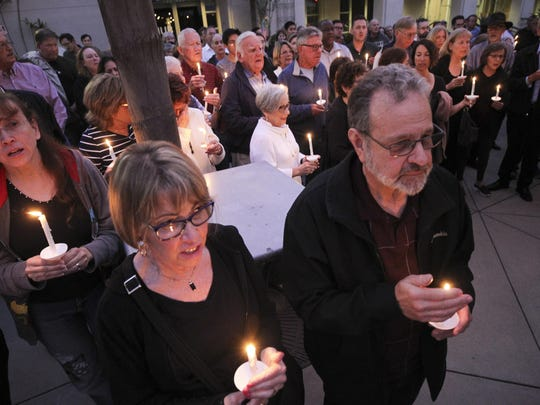People from the community, many of them of various faiths, join members of the Rancho Bernardo Community Presbyterian Church in a candlelight vigil for the Chabad of Poway synagogue shooting victims at the Rancho Bernardo Community Presbyterian Church in the Rancho Bernardo neighborhood of San Diego, Calif., Saturday, April 27, 2019. (Hayne Palmour IV/The San Diego Union-Tribune via AP)