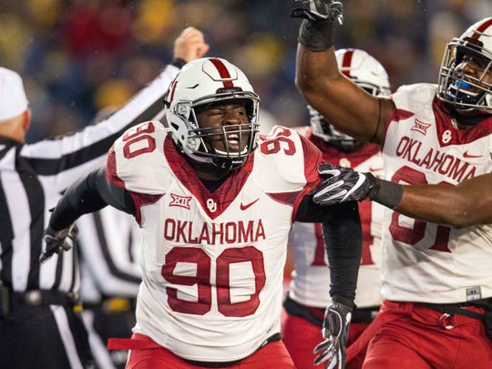 Nov 19, 2016; Morgantown, WV, USA; Oklahoma Sooners defensive lineman Neville Gallimore (90) celebrates after sacking the quarterback during the third quarter against the West Virginia Mountaineers at Milan Puskar Stadium. Mandatory Credit: Ben Queen-USA TODAY Sports