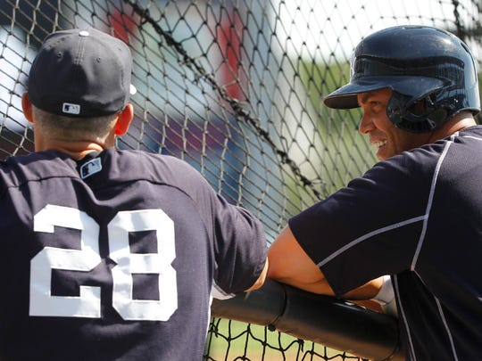 Yankees right fielder Carlos Beltran and manager Joe Girardi (28) talk prior to a spring training game.