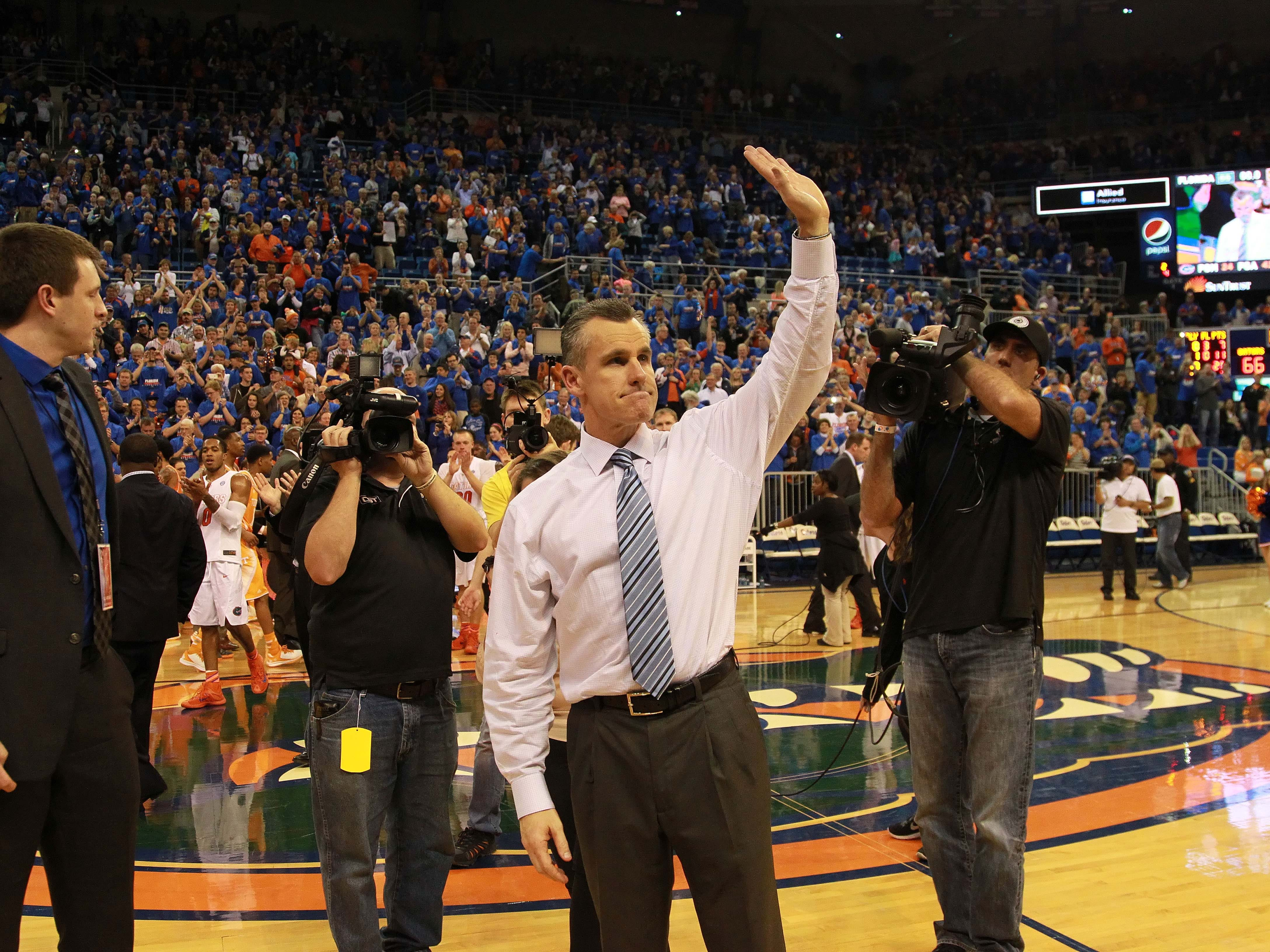 Florida Gators head coach Billy Donovan waves to the fans after reaching his 500th career win against the Tennessee Volunteers at the Stephen C. O'Connell Center. The Gators won 66-49.