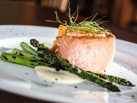 About 40 Indianapolis area restaurants are marking National Seafood Month on Friday. The Stuffed Salmon is often on the menu at Tavern on South, 423 W. South St.