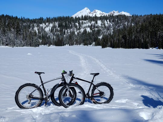 A pair of fat bikes are seen at Todd Lake in Central Oregon. One of the better fat bike routes follows a snowshoe trail to Todd Lake.