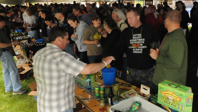 Samples are poured under the tasting tent for guests at a past Door County Beer Festival. This year's festival of craft brewers takes place June 16 in Baileys Harbor.