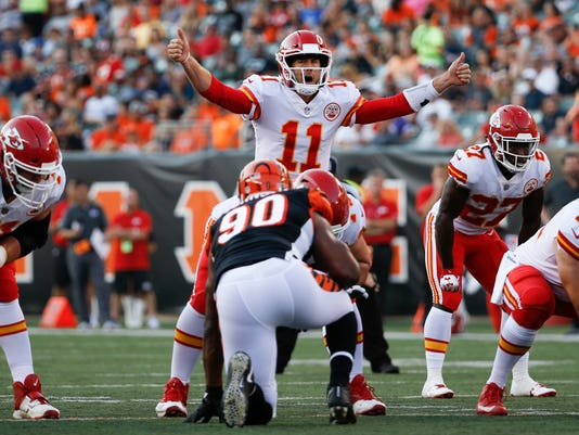 Kansas City Chiefs quarterback Alex Smith (11) directs his players during the first half of an NFL preseason football game against the Cincinnati Bengals, Saturday, Aug. 19, 2017, in Cincinnati. (AP Photo/Frank Victores)