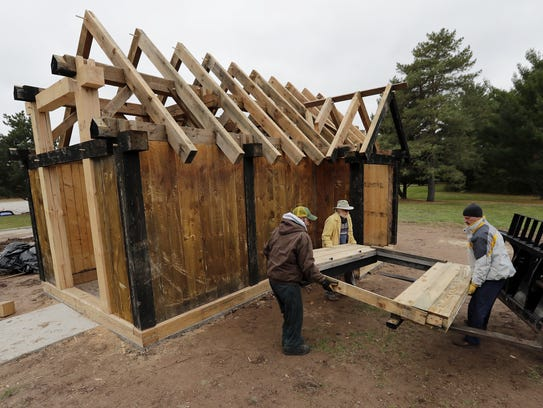 A door is unloaded outside a replica of a Viking-age