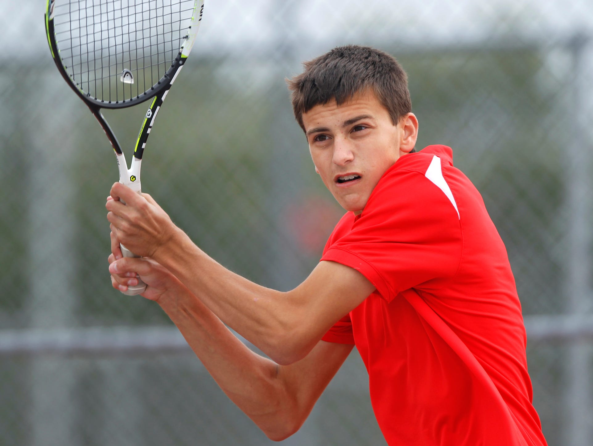 West Lafayette's Ryan Hollis watches his return against Lafayette Jeff's Jack Moulton in No. 1 singles during the boys tennis sectional championship Friday, October 2, 2015, at Cumberland Courts in West Lafayette.