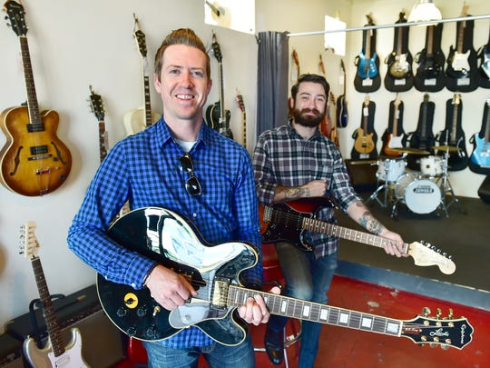 Fondren Guitars owner Patrick Harkins, left, is expanding his business with assistance from J.D. Burns, store manager.