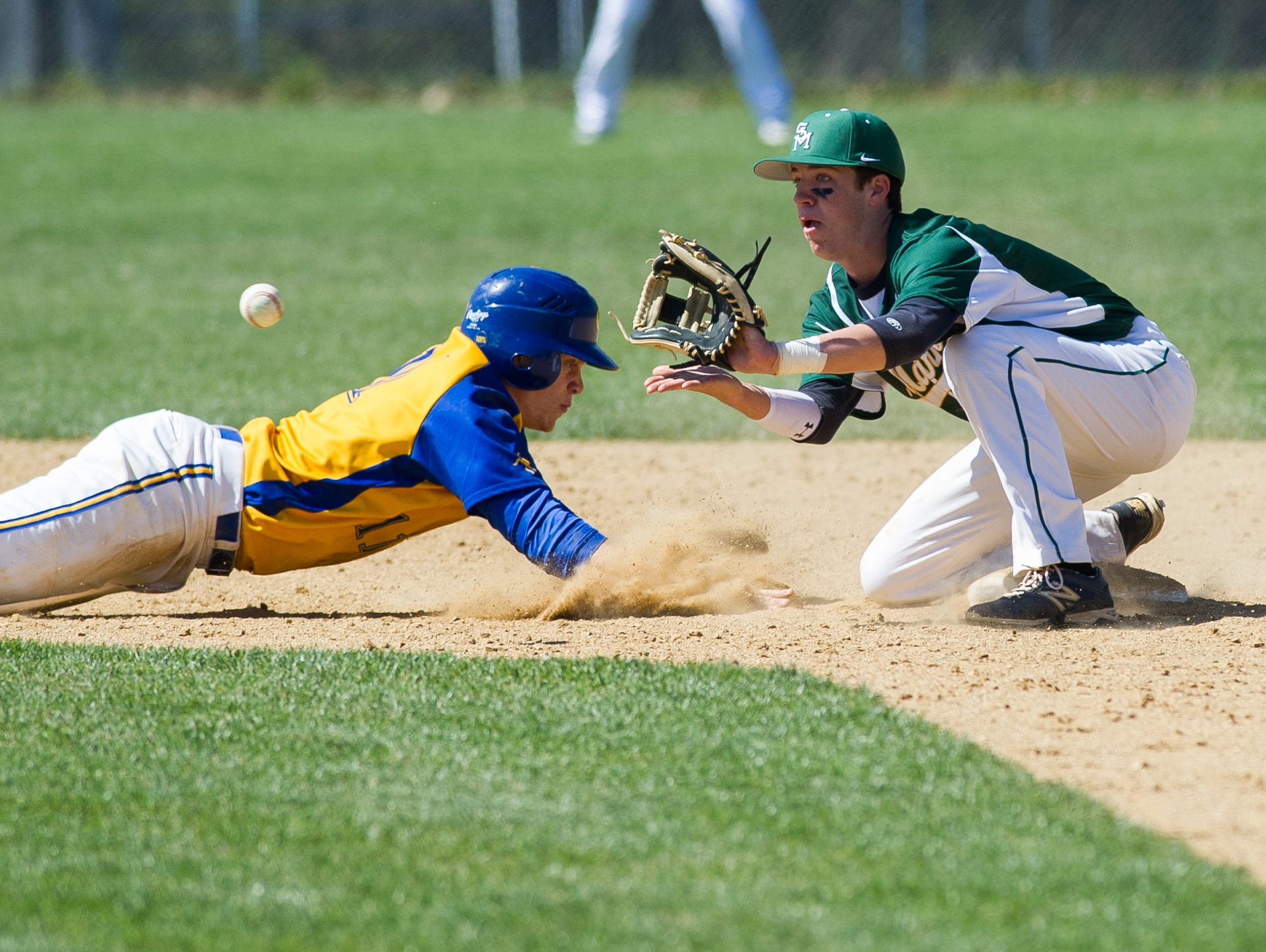 St. Mark's Brian Gilardi (1) tries to tag out Caesar Rodney's Quintin Ivy (11) at second base.
