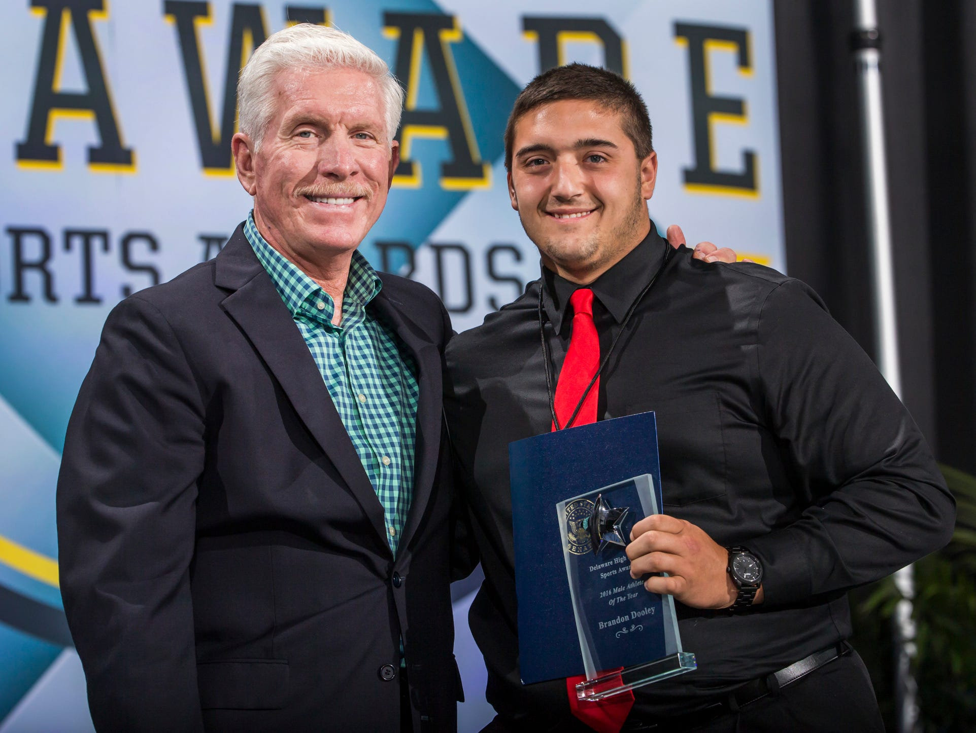 William Penn's Brandon Dooley poses with Mike Schmidt after being named the male athlete of the year at the Delaware Sports Awards banquet at the Bob Carpenter Center at the University of Delaware in Newark on Wednesday evening.