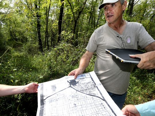 Pat Cummins shows an old map of Jefferson as he stands on what was the former square of the town of Jefferson that was destroyed as part of the Percy Priest Lake property. One of the Trail of Tears routes ran through this town.