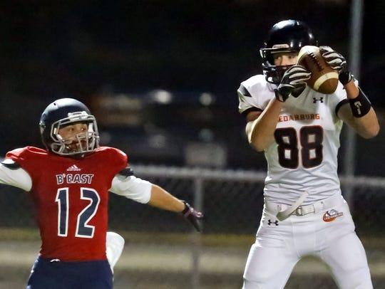 Cedarburg's Mitch Moeller hauls in a pass in front