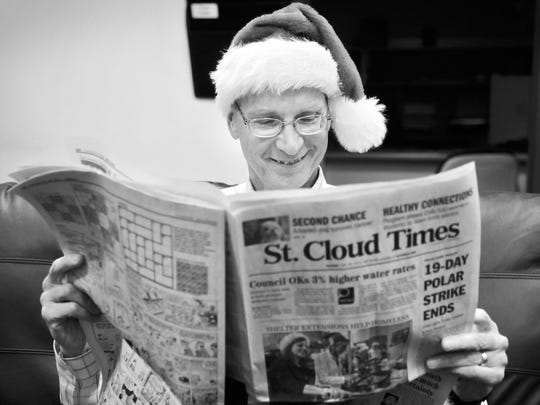 Times Executive Editor John Bodette gets in a festive mood and relaxes with a St. Cloud Times in 2011.