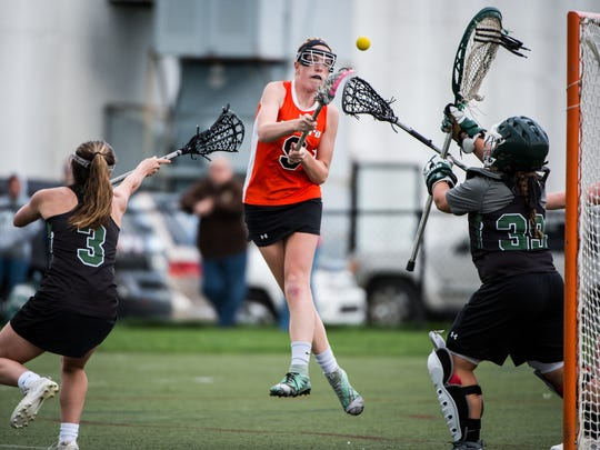 Palmyra's Nikki Bowman rips a shot past Central Dauphin goaltender Jordan Vereb as Palmyra beat Central Dauphin 20-18 on Tuesday, May 2, 2017.