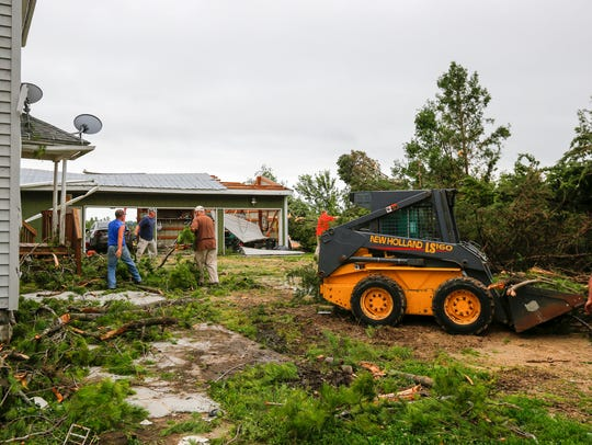 Friends clean up tornado damage at Justin Plein's home