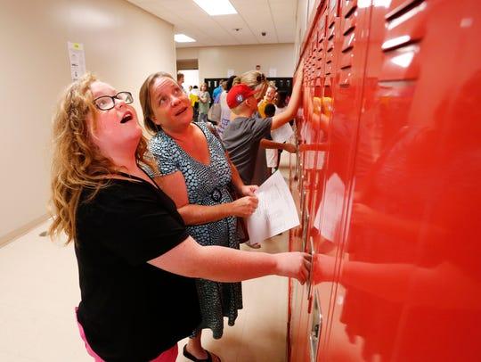 Olivia Walton and her mother Karen locate her locker