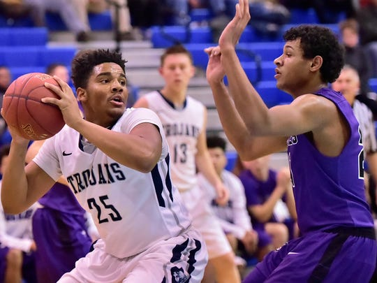 Chambersburg's Tyrell Williams works the bll inside against Tyreen Smalley. Chambersburg hosted Mifflin County in basketball on Tuesday, Dec. 12, 2017. Trojans defeated the Huskies 45-43.