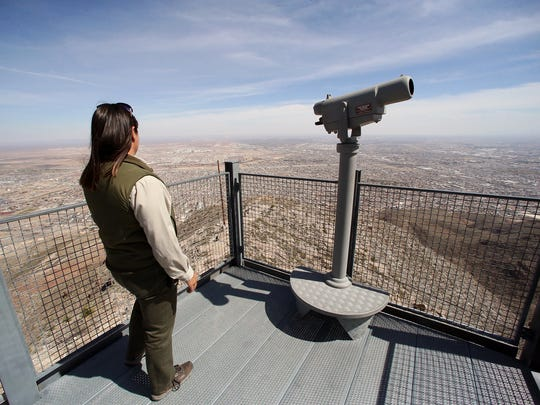 Park interpreter Diana Moy takes in the view at the Wyler Aerial Tramway scenic overlook atop the Franklin Mountains. Currently, most of the park's visitors are from out of town, but park officials hope to attract more local residents.