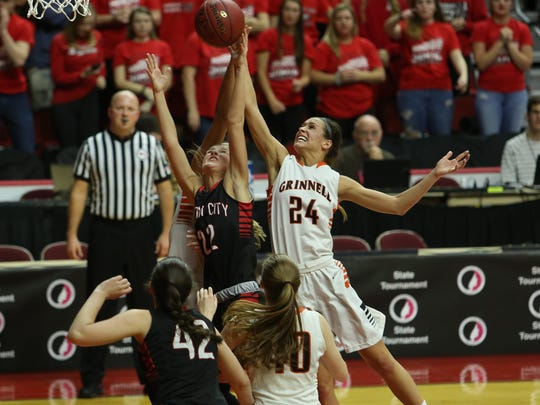 Grinnell's Kameron Moore, 24, goes up for a rebound with Mason City's Hannah Faktor, 22, during the Tigers' 70-51 quarterfinal win in the Class 4A state tournament.