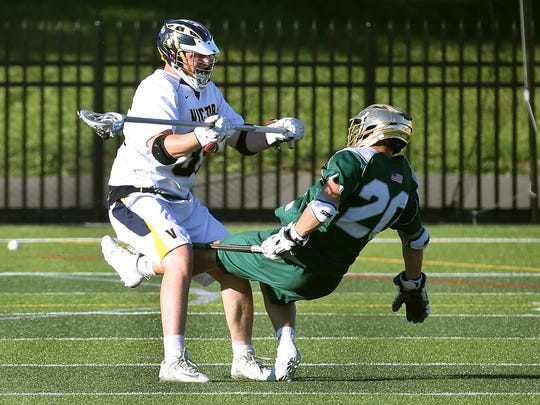 Victor's Mike Novitsky is called for the roughing penalty with this hit on Vestal's Logan Wiland (20).