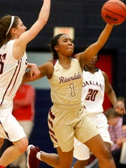 Riverdale's Alasia Hayes (1) grabs a loose ball and takes off down the court as Oakland's Sloan Mann (15) goes for the same ball on Friday, Jan. 5, 2018, at Oakland.