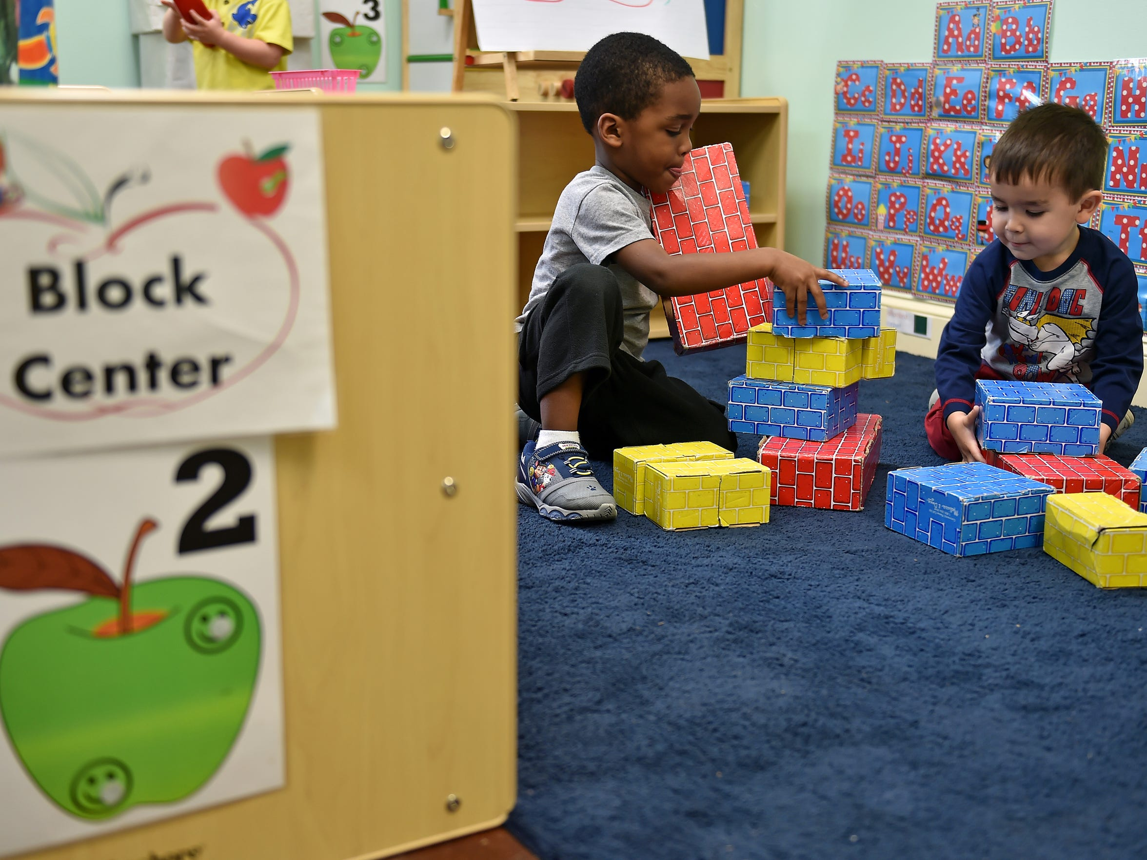 Alonzo Crosby, left, and Oliver Hollingsworth, both 3, play with blocks Tuesday at Lake Village Learning Center in Flowood. The center is getting help from Mississippi Building Blocks, a state-funded program designed to assist licensed child care centers to improve the school readiness of children.