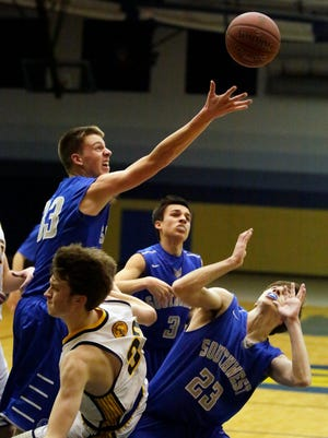 Green Bay Southwest's Will Pytleski (33) reaches for a rebound against Sheboygan North last season. Pytleski scored a game-high 27 points for the Trojans on Tuesday.