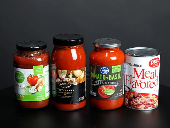 Four varieties of Kroger brand tomato sauces, ranging