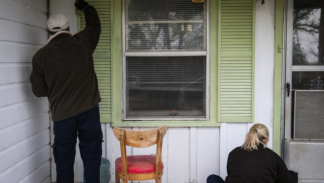 Helping Hands volunteers paint the Cortez's house Saturday, April 7, 2018, in San Angelo.