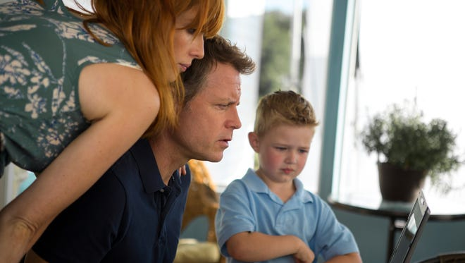 "Kelly Reilly, Greg Kinnear and Connor Corum in a scene from the motion picture ""Heaven Is For Real."""