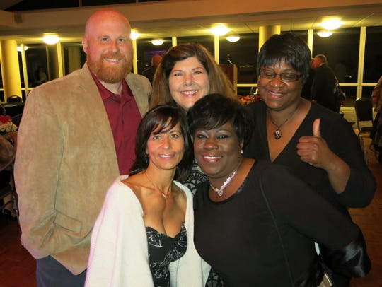 Celebrators at party for Dr. Michael G. Futrell: Gwen