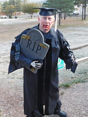 """A """"zombified"""" campus president Dr. Clayton Alred joined in the fun for the run."""