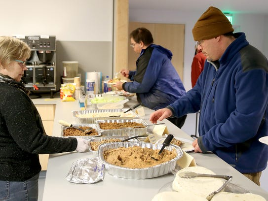 Volunteer Karin Evensta works the meal line at the