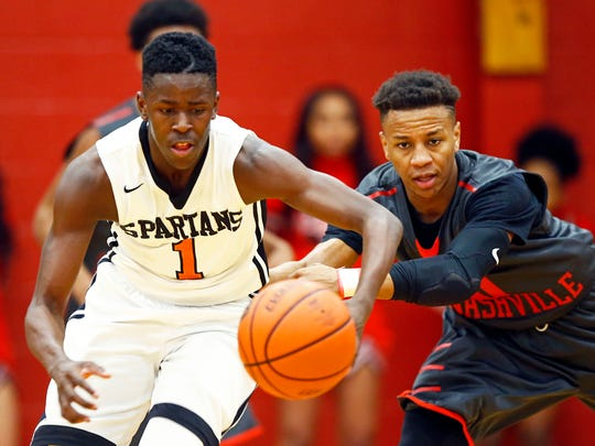 Stratford's Juwan Carpenter (1) chases after the ball