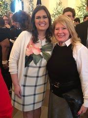 Sarah Huckabee Sanders, left, with Naples resident Diane Olivo