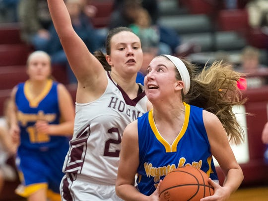 Waynesboro's Olivia Gardenhour (10) takes a shot while being guarded by Shippensburg's Shannon Staver (22) during a girls basketball game on Tuesday, Jan. 3, 2016. Waynesboro defeated Shippensburg 59-42.