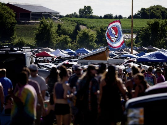 A Grateful Dead banner flies above tailgaters at the Dead & Company concert at Alpine Valley Music Theatre in East Troy in 2018.