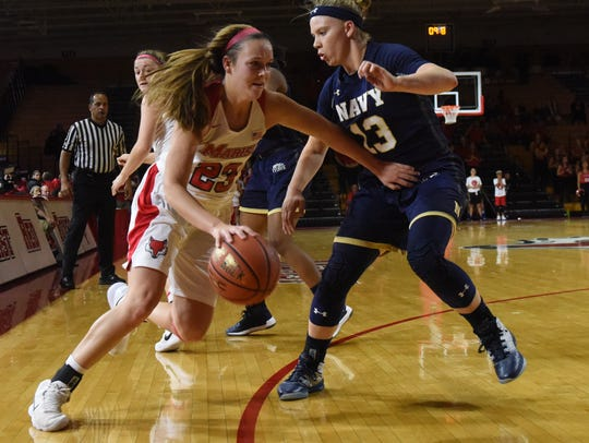 Marist College's Rebekah Hand drives baseline as Navy's